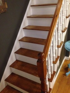 We kept the newel post wooden, but you could paint it a contrasting color