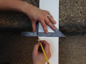 Use your handy dandy carpenter's square to make a nice right angle.