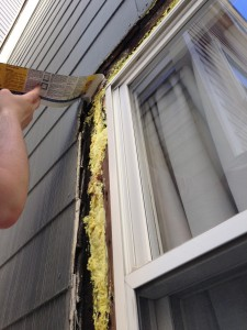 Pro-tip: Don't peel the paper off the flashing until it's in place.  This stuff will stick to anything and everything!