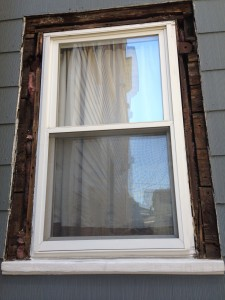 Here's how the window looked without any trim.  Note the boards as sheathing.