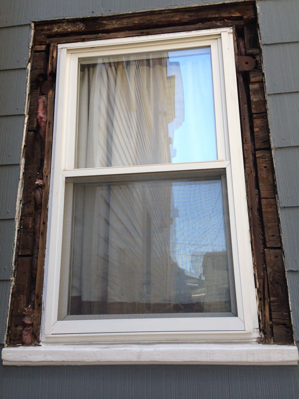 heres how the window looked without any trim note the boards as sheathing