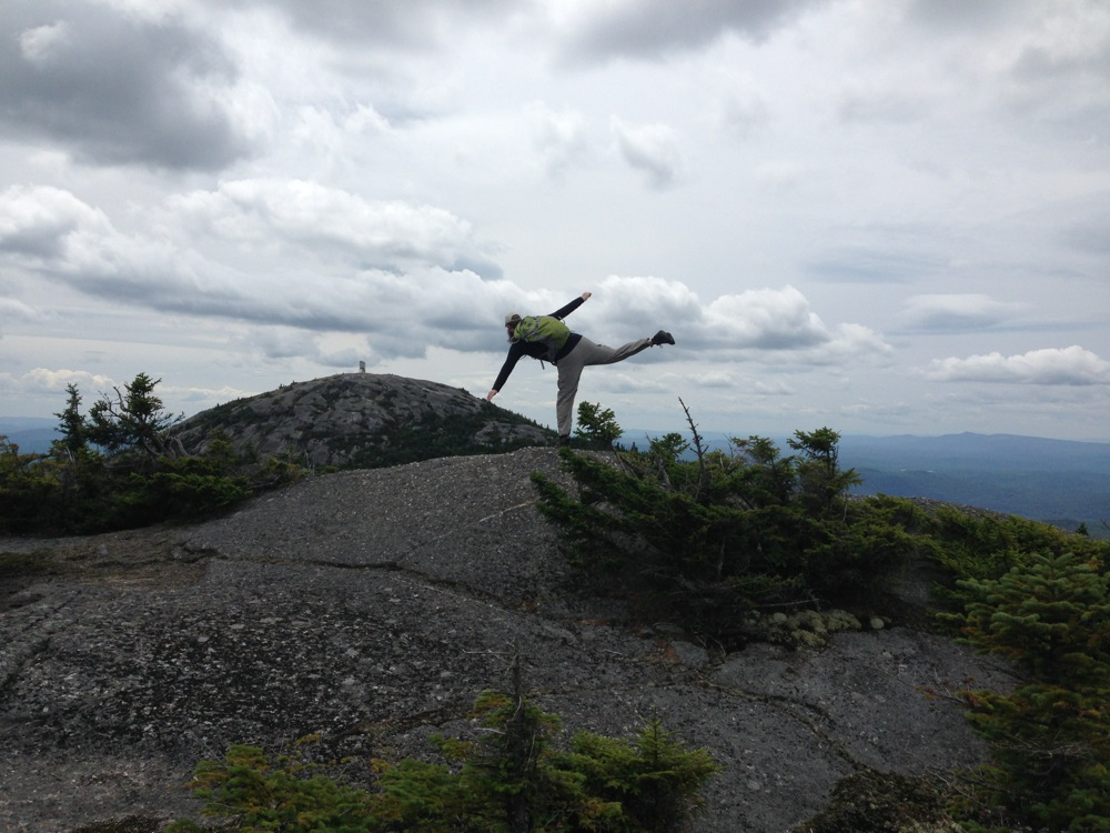 Mr. FW doing yoga on the Mt. Firescrew summit, facing Mt. Cardigan
