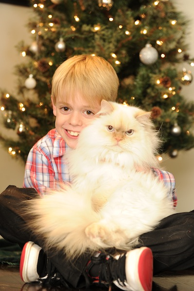 Shannon's son Will with Spumoni the cat