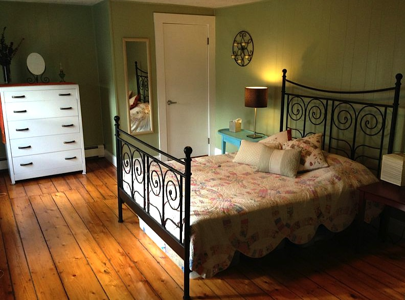 Guest room with second-hand dresser, hand-me-down quilt, and a used table I re-painted