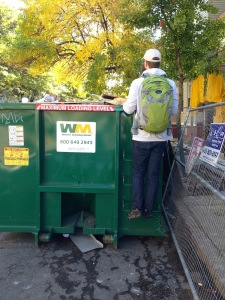 Mr. FW investigating a dumpster: definitely embracing the frugal weirdo