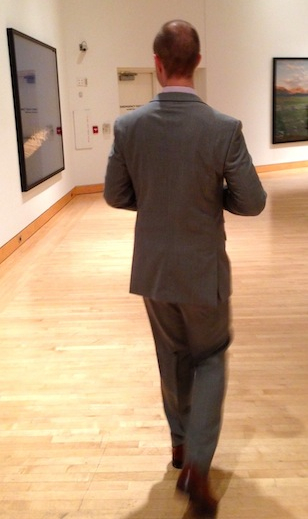 Mr. FW looking at some art at a wedding
