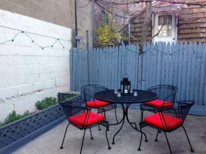 Our patio last summer, sans snow
