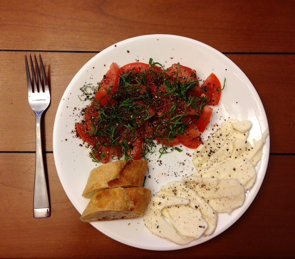 A tasty Caprese Salad with homemade bread