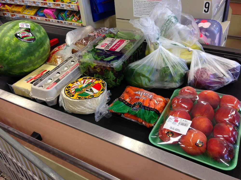 Our haul on the conveyor belt. I ate most of that watermelon myself, just sayin.