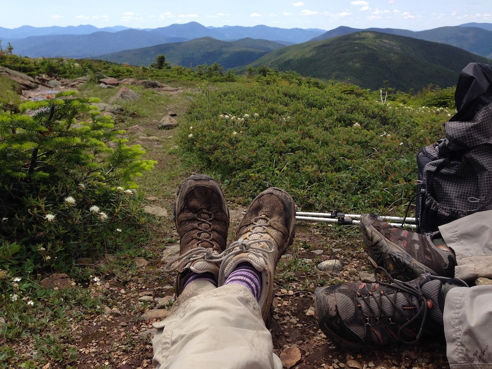 Enjoying our lunch break, nestled into a rock on the ridge walk between peaks