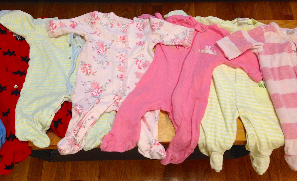 A few of Babywoods' used onesies