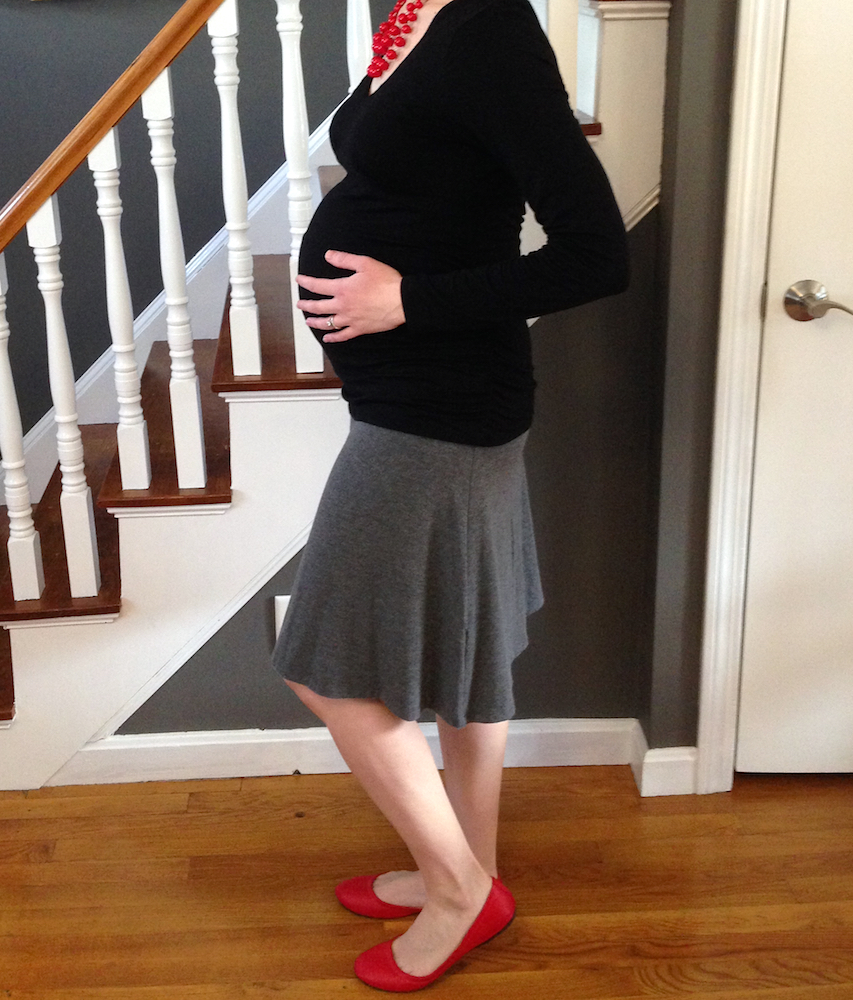Me at 39 weeks pregnant in my hand-me-down maternity garb