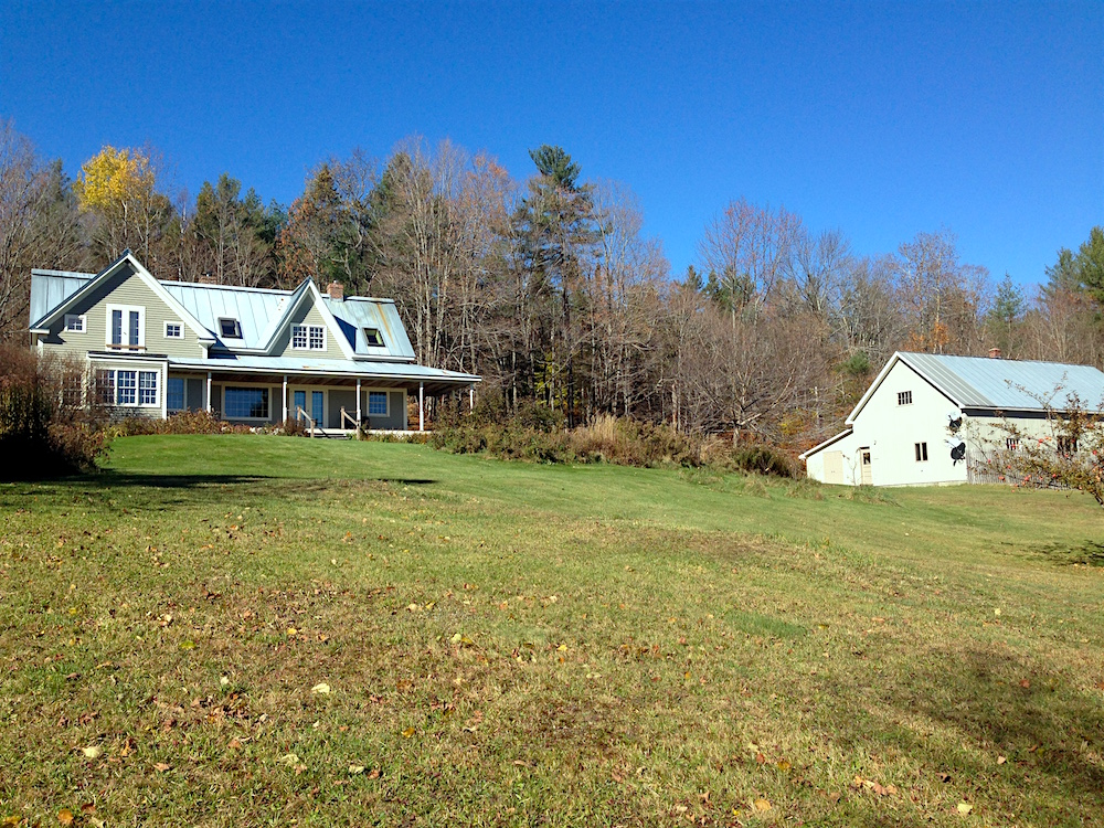 The house and barn--located atop a slight hill