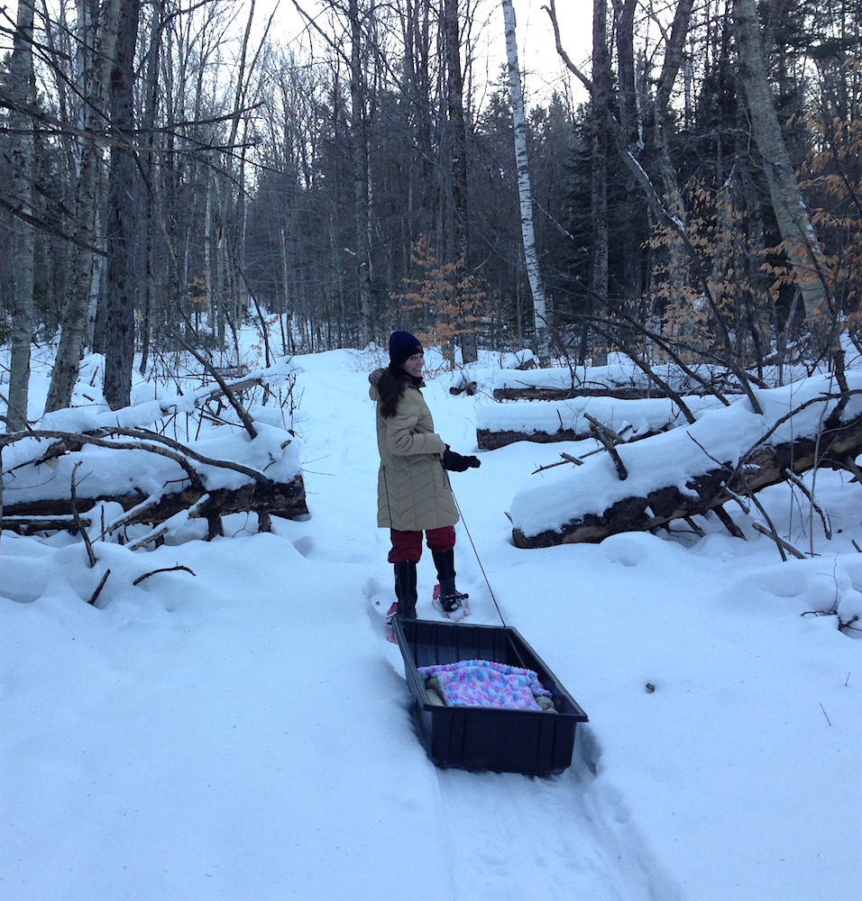 Me towing Babywoods in the game sled up our woodland trail.