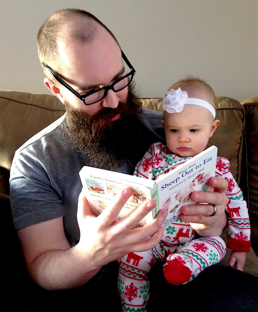 c2f43d9334 Mr. FW reading to Babywoods in his free (and uncomfortable) glasses